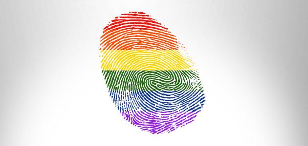 Audiodescrição: Na imagem, uma impressão digital nas cores da bandeira LGBT. fim da audiodescrição